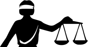 A blindfolded woman - Justicia - holding up scales. The blindfold is a symbol of equal justice for everybody.