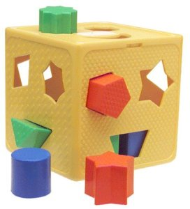 A Toy for toddlers. Simple blocks have to be put through holes. Each block will only fit through the hole with the correct shape. This toy is meant for 3 year olds or younger.