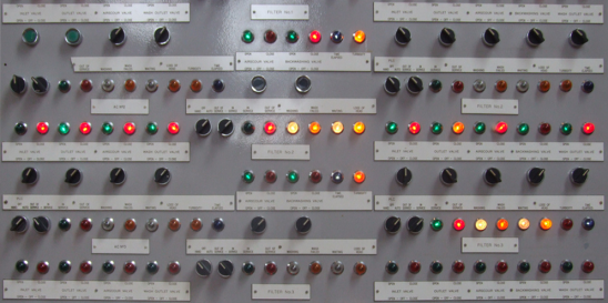 A control panel with about one hundred buttons that all look the same.