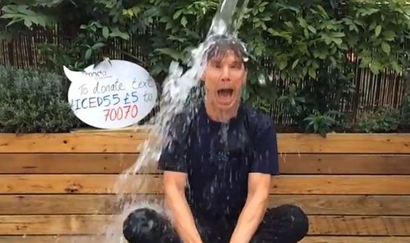 Actor Benedict Cumberbatch sits on a bench shivering, while being doused with ice water from above.